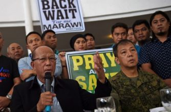 (File photo) Philippine Defense Secretary Delfin Lorenzana (L) speaks while Lieutenant General Carlito Galvez, Western Mindanao military commander, listens during a dialogue between displaced Marawi residents and government officials in Iligan City on the southern island of Mindanao on July 23, 2017, as fighting between government troops and Islamist militants enters its second month.  / AFP PHOTO / TED ALJIBE