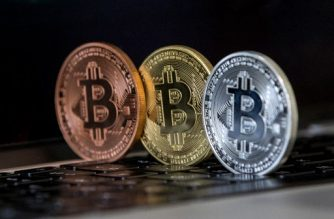 "(File photo) A picture taken on February 6, 2018 shows a visual representation of the digital crypto-currency Bitcoin, at the ""Bitcoin Change"" shop in the Israeli city of Tel Aviv. / AFP Photo / Jack Guez"