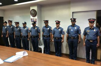 The nine policemen who reported to PNP Chief Oscar Albayalde after they allegedly bashed him online.