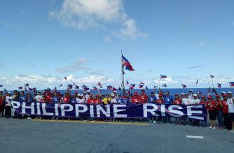 Several people on board BRP Davao del Sur that is off the waters of Casiguran, Aurora pose for a picture on Wednesday, May 17. The government celebrates one year since Benham Rise, the undersea plateau, was named Philippine Rise./Mar Gabriel/Eagle News Service/