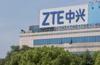 "This picture taken on May 3, 2018 shows the ZTE logo on an office building in Shanghai.    Chinese telecom giant ZTE said its major operations had ""ceased"" following last month's US ban on American sales of critical technology to the company, raising the possibility of its collapse. / AFP Photo / Johannes Eisele"