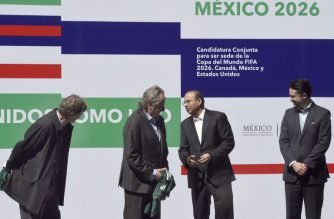 (L to R) Mexican Tourism minister, Enrique de la Madrid, Decio de Maria, president of the Mexican Football Federation, Mexican Interior minister, Alfonso Navarrete, and Yon de Luisa, director of the joint bid for the next soccer 2026 World Cup in North America, take part in a ceremony during the launching of Mexico, US and Canada candidacy to organize the FIFA World Cup 2026, at the Azteca stadium in Mexico City on February 16, 2018.  The United States, Mexico and Canada announced a joint bid to stage the 2026 World Cup on Monday, aiming to become the first three-way co-hosts in the history of FIFA's showpiece tournament.  / AFP PHOTO / ALFREDO ESTRELLA