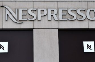 A logo of Nespresso, an operating unit of the Swiss Nestle Group, is on display at a store in Brussels, on February 8, 2018.  / AFP PHOTO / Emmanuel DUNAND