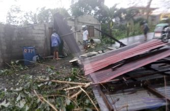 Galvanized iron roofing are seen on the road together with various other debris, including several broken branches, after typhoon Ompong passed Ilocos Norte., and other parts of Northern Luzon. Eagle News Service photo)