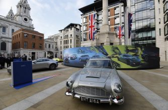 Models of cars by luxury British sports car manufacturer Aston Martin are parked outside the London Stock Exchange on October 3, 2018 in London as the company is floated on the market. The car brand, favoured by fictional spy James Bond 007, said in a statement that it has priced its initial public offering (IPO) at £19 per share and will begin trading at 0700 GMT. / AFP PHOTO / Tolga AKMEN