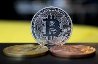"A picture taken on February 6, 2018 shows a visual representation of the digital crypto-currency Bitcoin, at the ""Bitcoin Change"" shop in the Israeli city of Tel Aviv. (Photo by JACK GUEZ / AFP)"