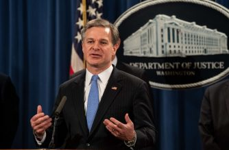 """FBI Director Christopher Wray speaks at a press conference about Chinese hacking at the Justice Department in Washington, DC, on December 20, 2018. - The US Justice Department on Thursday announced fresh indictments of Chinese government hackers who allegedly targeted scores of companies in a dozen countries, which US officials said showed Beijing had not fulfilled its pledge to stop such actions. In an operation coordinated with US allies in Europe and Asia, Deputy Attorney General Rod Rosenstein said the move was being made to rebuff """"China's economic aggression."""" (Photo by NICHOLAS KAMM / AFP)"""
