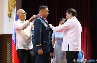 President Rodrigo Roa Duterte confers the Philippine Legion of Honor (PLOH) with the Degree of Commander to outgoing Philippine Air Force (PAF) Commanding General Lieutenant General Galileo Gerard Kintanar, Jr. during the PAF Change of Command Ceremony at the PAF Multipurpose Gym, Villamor Air Base (VAB) in Pasay City on December 21, 2018. Assisting the President is Defense Secretary Delfin Lorenzana. REY BANIQUET/PRESIDENTIAL PHOTO