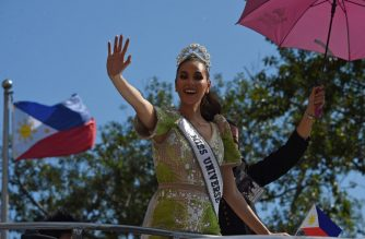 Miss Universe 2018 Catriona Gray of the Philippines waves to fans during a parade held in her honour in Manila on February 21, 2019, two months since she won the crown. (Photo by TED ALJIBE / AFP)
