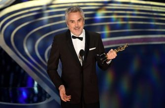 """Best Cinematography nominee for """"Roma"""" Alfonso Cuaron accepts the award for Best Cinematography during the 91st Annual Academy Awards at the Dolby Theatre in Hollywood, California on February 24, 2019. (Photo by VALERIE MACON / AFP)"""