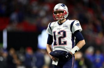 ATLANTA, GEORGIA - FEBRUARY 03: Tom Brady #12 of the New England Patriots warms up on to the field prior to Super Bowl LIII against the Los Angeles Rams at Mercedes-Benz Stadium on February 03, 2019 in Atlanta, Georgia.   Patrick Smith/Getty Images/AFP