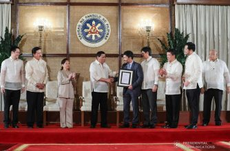 President Rodrigo Roa Duterte presents the signed Philippines Sports Training Center Act to Senator Emmanuel Pacquiao during a ceremony at the Malacañan Palace on February 20, 2019. ROLANDO MAILO/PRESIDENTIAL PHOTO
