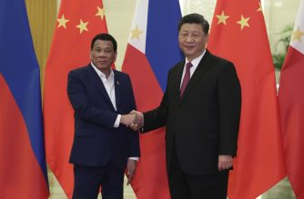 Philippine President Rodrigo Duterte (L) shakes hands with Chinese President Xi Jinping before their meeting at the Great Hall of People in Beijing on April 25, 2019. (Photo by Kenzaburo FUKUHARA / POOL / AFP)