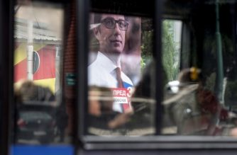 The electoral poster of presidential candidate Stevo Pendarovski from the ruling party SDSM is seen through the window of a bus in Skopje on April 18, 2019, ahead of April 21 presidential election. - North Macedonia holds the first round of its presidential election on April 21, the country's first vote under a new name as it struggles with enduring economic problems, cronyism and corruption. The vote for the largely ceremonial post comes less than three months after a deal with Athens on Skopje's name change came into force, ending a decades-long identity dispute between the neighbours. (Photo by Robert ATANASOVSKI / AFP)