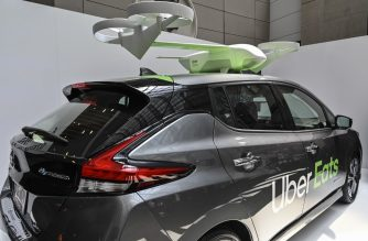 An Uber Eats car and drone is on exhibit at the Uber Elevate Summit 2019 in Washington, DC June 12, 2019. - Uber said Wednesday it plans to speed up restaurant meal delivery by using drones for its Uber Eats service. For logistical reasons, the drones will not deliver directly to customers, but to a safe drop-off location where an Uber Eats driver will complete the order. In the future, Uber hopes to land the drones on parked vehicles located near each delivery location to allow the final delivery by hand. Uber said it had developed a proprietary airspace management system called Elevate Cloud Systems that will guide the drones to their location. (Photo by EVA HAMBACH / AFP)