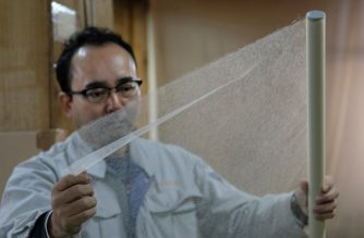 "This picture taken on March 15, 2019 shows Hidaka Washi president Hiroyoshi Chinzei, a fourth-generation traditional paper maker, displaying the world's thinnest paper at his factory in Hidaka, Kochi prefecture, some 640 kilometres (400 miles) southwest of Tokyo. - Once indispensible for the daily life of Japanese, washi -- literally ""Japanese paper"" -- was used not only for writing and painting but also for sliding doors, room dividers, lampshades and umbrellas. (Photo by Kazuhiro NOGI / AFP) / TO GO WITH Japan-culture-lifestyle,FEATURE by Natsuko FUKUE"