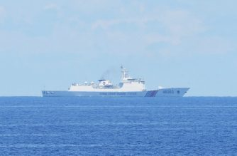 (File photo) This photo taken on May 14, 2019, Chinese coastguard ship monitors during the  joint search and rescue exercise between Philippine and US coastguards near Scarborough shoal in the South China Sea. - Two Philippine coastguard ships, BRP Batangas and Kalanggaman and US coastguard cutter Bertholf participated in the exercise, as two Chinese coastguard ships monitor from a distance. (Photo by TED ALJIBE / AFP)