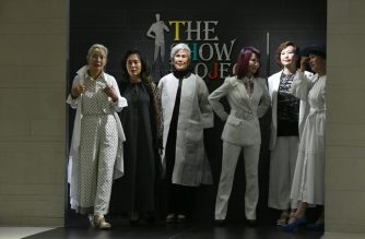 This picture taken on June 11, 2019 shows model Choi Soon-hwa (3rd L) and her colleagues during a modelling class at a model academy in Seoul. - Sleek and straight-backed with elegant grey hair, Choi, 75, is one of a handful of seniors who have become social media and fashion celebrities in a country where intergenerational conflict is mounting as the population ages. (Photo by Jung Yeon-je / AFP) / TO GO WITH SKorea-social-fashion-population, FEATURE by Claire LEE