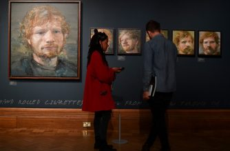 Portraits of British musician Ed Sheeran, painted by Irish artist Colin Davidson, are pictured on display during a press preview of the exhibition 'Ed Sheeran: Made in Suffolk' in Ipswich, east England on August 19, 2019. - Ipswich, in eastern England has historically prided itself on farming and football, but is now celebrating the stellar pop career of its most famous son, Ed Sheeran. The global hit machine's journey to stardom began in the nearby town of Framlingham, where he played his first gig in front of around 30 people. (Photo by Daniel LEAL-OLIVAS / AFP) / RESTRICTED TO EDITORIAL USE - MANDATORY MENTION OF THE ARTIST UPON PUBLICATION - TO ILLUSTRATE THE EVENT AS SPECIFIED IN THE CAPTION TO GO WITH AFP STORY by Pauline Froissart