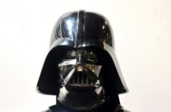 """A Darth Vader helmet and mask from the film """"The Empire Strikes Back"""" on display at the Profiles in History auction house on August 28, 2019 in Calabasas, California ahead of """"The Icons and Legends of Hollywood Auction"""" on September 25 and 26. - Darth Vader's helmet from """"The Empire Strikes Back"""" is among a vast collection of coveted Hollywood treasures going under the hammer next month, with experts predicting it could fetch nearly half-a-million dollars. (Photo by Frederic J. BROWN / AFP)"""