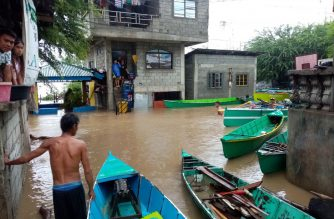 Boats are used by people as a means for transportation as roads are transformed into virtual rivers because of the floods brought about by severe tropical storm Ineng's non-stop rains in Ilocos Norte.  (Eagle News Service)