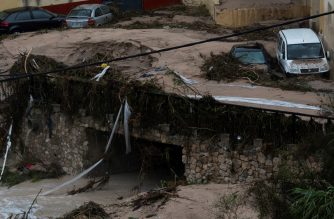 Damaged cars are pictured after a street was flooded in Ontinyent on September 12, 2019 as torrential rains hit southeastern Spain overnight, sparking major flooding in the Valencia region and closing schools in a move affecting a quarter of a million children. (Photo by JOSE JORDAN / AFP)