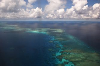 This photo taken on April 21, 2017 shows an aerial shot of part of mischief reef in the disputed Spratly islands on April 21, 2017. - Philippine Defence Secretary Delfin Lorenzana flew to a disputed South China Sea island on April 21, brushing off a challenge by the Chinese military while asserting Manila's territorial claim to the strategic region. (Photo by TED ALJIBE / AFP)