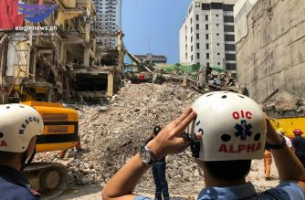 Authorities had to use a crane to penetrate the Sogo hotel in Malate, Manila, a portion of which collapsed on Monday, Sept. 23. /Moira Encina/Eagle News/