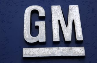 """A sign is viewed at the General Motors Detroit-Hamtramck Assembly as they announced the closing of multiple facilities including this one on November 26, 2018 in Detroit, Michigan. - In a massive restructuring, US auto giant General Motors announced Monday it would cut 15 percent of its workforce to save $6 billion and adapt to """"changing market conditions."""" The moves include shuttering seven plants worldwide as the company responds to changing customer preferences and focuses on popular trucks and SUVs and increasingly on electric models.GM will shutter three North American auto assembly plants next year: the Oshawa plan in Ontario, Canada; Hamtramck in Detroit, Michigan and Lordstown in Warren, Ohio.In addition, it will close propulsion plants -- which produce batteries and transmissions -- in Baltimore, Maryland and Warren, Michigan, as well two more unidentified plants outside of North America. (Photo by JEFF KOWALSKY / AFP)"""