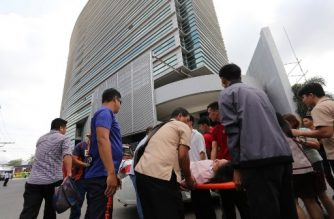 An office worker is carried on a stretcher after she fainted at the height of the earthquake that hit Davao City, in southern island of Mindanao on October 29, 2019. - A 6.6-magnitude quake struck the southern Philippines on October 29, authorities said, causing injuries and damaging buildings in a region still reeling from a previous deadly tremor. Terrified locals fled into the streets after the shallow quake, which the US Geological Survey said hit the island of Mindanao as schools and offices opened for the day. (Photo by Manman Dejeto / AFP)