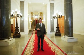 President Rodrigo  Duterte strikes his signature pose as he is given a tour inside the Kremlin Palace in Moscow, Russian Federation on October 4, 2019. KING RODRIGUEZ/PRESIDENTIAL PHOTO