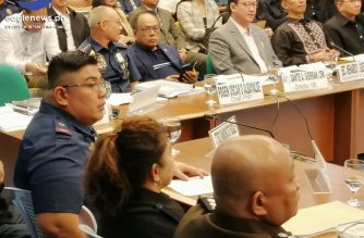 Rodney Baloyo (with right arm over chair), then a colonel, has denied arresting one Johnson Lee in a Pampanga raid his team conducted in 2013./Meanne Corvera/Eagle News/