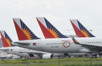 (File photo) In this photo taken on September 13, 2016 shows Philippine airlines planes are parked at the international airport of Manila. (Photo by TED ALJIBE / AFP)