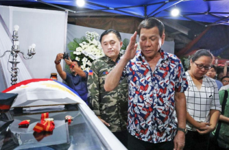 President Rodrigo Duterte salutes John Magno, who died while protecting students at the Intiao College campus on Nov. 28./Bong Go/