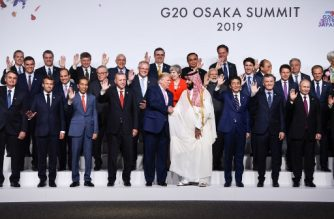 US President Donald Trump shakes hands with Saudi Arabia's Crown Prince Mohammed bin Salman as leaders pose for a family photo at the G20 Summit in Osaka on June 28, 2019. (Photo by Brendan Smialowski / AFP)
