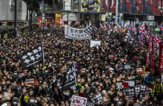 People take part in a pro-democracy march in Hong Kong on January 1, 2020. - Tens of thousands of protesters marched in Hong Kong during a massive pro-democracy rally on New Year's Day, looking to carry the momentum of their movement into 2020. (Photo by ISAAC LAWRENCE / AFP)