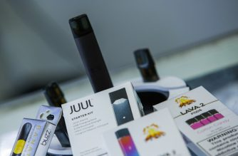 JERSEY CITY, NJ - JANUARY 02: E-cigarettes devices are display in a local store on January 2, 2020 in Jersey City, New Jersey. The Trump administration will announce this week the ban for mint-, fruit- and dessert-flavored e-cigarette cartridges, but allow menthol and tobacco flavors to remain on the market. Flavored liquid nicotine used in open tank systems can continue to be sold.   Eduardo Munoz Alvarez/Getty Images/AFP