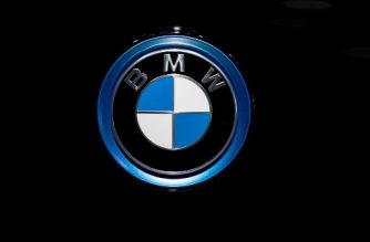 A BMW automobile logo is pictured during the Brussels Motor Show on January 9, 2020 in Brussels. (Photo by Kenzo TRIBOUILLARD / AFP)