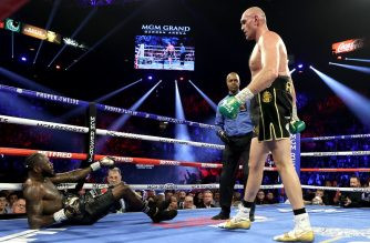 LAS VEGAS, NEVADA - FEBRUARY 22: Tyson Fury knocks down Deontay Wilder in the third round during their Heavyweight bout for Wilder's WBC and Fury's lineal heavyweight title on February 22, 2020 at MGM Grand Garden Arena in Las Vegas, Nevada.   Al Bello/Getty Images/AFP