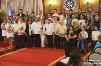 President Rodrigo Duterte poses for a photo with the first batch of the 12th Ani ng Dangal awardees in Malacanang on Wednesday, Feb. 26, 2020.  (Screengrab from RTCM video/Courtesy RTVM/Malacanang)
