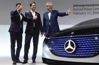 """Ola Kaellenius (C), CEO of Daimler AG, Harald Wilhelm, (L) CFO of Daimler AG and Martin Daum (R), member of the executive board and CEO of Daimler Trucks AG pose during the company's annual press conference in Stuttgart, southern Germany, on February 11, 2020. - Mercedes-Benz parent company Daimler reported plunging profits for 2019, after setting aside billions of euros to deal with potential fallout from the industry-wide """"dieselgate"""" emissions cheating scandal. (Photo by THOMAS KIENZLE / AFP)"""