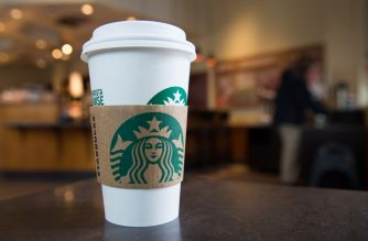 "(FILES) In this file photo taken a Starbucks coffee cup is seen indide a Starbucks coffee shop in Washington, DC, April 17, 2018. - Reusable cups are in vogue for reducing waste but are no longer welcome at Starbucks cafes over fears of the coronavirus, the coffee chain announced. ""We are pausing the use of personal cups and 'for here' ware in our stores,"" Rossann Williams, an executive vice president, said in a statement March 4, 2020, adding that Starbucks would still give a 10-cent discount to customers who bring their own cup. (Photo by SAUL LOEB / AFP)"