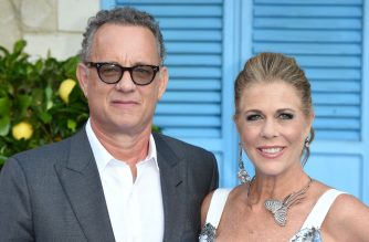 """(FILES) In this file photo Tom Hanks and Rita Wilson pose on the red carpet upon arrival for the world premiere of the film """"Mamma Mia! Here We Go Again"""" in London on July 16, 2018. - Tom Hanks and his wife Rita Wilson have both tested positive for coronavirus, the US actor said Wednesday. Hanks, 63, said he and Wilson came down with a fever while in Australia, and will now be isolated and monitored. (Photo by Anthony HARVEY / AFP)"""