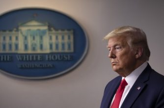 WASHINGTON, DC - MARCH 22: U.S. President Donald Trump listens during the daily coronavirus briefing in the James Brady Press Briefing Room at the White House on March 22, 2020 in Washington, DC. During the briefing President Trump announced thatthe National Guard will be deployed to New York, Washington State and California. Congress continues to work on legislation this weekend for a trillion dollar aid package to fight the coronavirus (COVID-19) pandemic.   Tasos Katopodis/Getty Images/AFP
