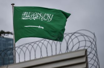 A Saudi Arabia flag flies on the top of their consulate building on January 10, 2019 in Istanbul. - Amnesty International called on January 10 for an international investigation on the murder of Saudi columnist Jamal Khashoggi, during a ceremony in front of the Saudi consulate in Istanbul marking the 100th day of his murder that sparked global outrage. (Photo by OZAN KOSE / AFP)