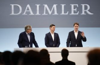 "(R-L) Ola Kaellenius, CEO of Daimler AG, Harald Wilhelm, CFO of Daimler AG and Martin Daum, member of the executive board and CEO of Daimler Trucks AG attend the company's annual press conference in Stuttgart, southern Germany, on February 11, 2020. - Mercedes-Benz parent company Daimler reported plunging profits for 2019, after setting aside billions of euros to deal with potential fallout from the industry-wide ""dieselgate"" emissions cheating scandal. (Photo by THOMAS KIENZLE / AFP)"