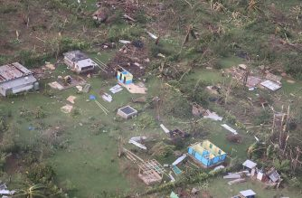 "This aerial handout photo taken and received on April 8, 2020 by the International Federation of Red Cross (IFRC) Pacific shows damaged houses in the aftermath of Tropical Cyclone Harold on the island of Santo in Vanuatu. - A deadly Pacific cyclone cut off communication links to Vanuatu's northern islands April 7, with aid officials saying they had grave concerns for residents in the remote areas. (Photo by Handout / International Federation of Red Cross Pacific / AFP) / RESTRICTED TO EDITORIAL USE - MANDATORY CREDIT ""AFP PHOTO / INTERNATIONAL FEDERATION OF RED CROSS PACIFIC"" - NO MARKETING NO ADVERTISING CAMPAIGNS - DISTRIBUTED AS A SERVICE TO CLIENTS --- NO ARCHIVE ---"
