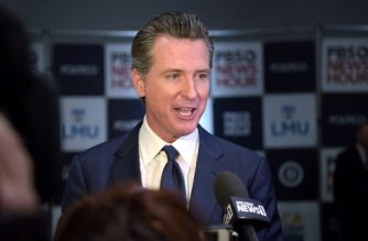 "(FILES) In this file photo taken on December 19, 2019 California Governor Gavin Newsom speaks to the press in the spin room after the sixth Democratic primary debate of the 2020 presidential campaign season co-hosted by PBS NewsHour & Politico at Loyola Marymount University in Los Angeles, California. - Governor Gavin Newsom on April 14, 2020 set out conditions for lifting California's coronavirus lockdown, but warned it would be at least two weeks before any timeline for reopening the state could be announced. Newsom said stay-at-home orders had ""bent the curve"" in the nation's most populous state, but warned against moving too quickly and insisted decisions should be based on science not politics. (Photo by Agustin PAULLIER / AFP)"