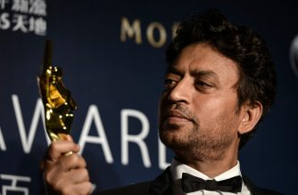 """(FILES) In this file photo taken on March 27, 2014 Best Actor winner Irrfan Khan poses with his trophy during the Asian Film Awards in Macau. - Acclaimed Indian actor Irrfan Khan, whose international movie career included hits like """"Slumdog Millionaire"""", """"Life of Pi"""" and """"The Amazing Spider-Man"""", has died aged just 53, his publicist said on April 29, 2020. (Photo by Philippe LOPEZ / AFP)"""