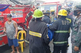 Firemen respond to the fire that killed at least six people on Thursday, April 30./AJ Zamora/Eagle News/